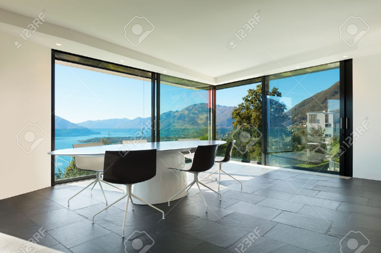 Interior of modern house wide dining room with glass walls stock photo 39039545