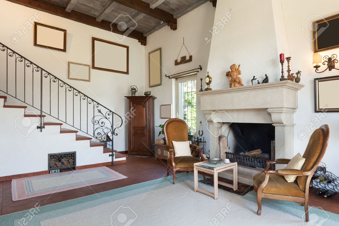 Interior Of Old House With Classic Furniture, Living Room With Fireplace  Stock Photo