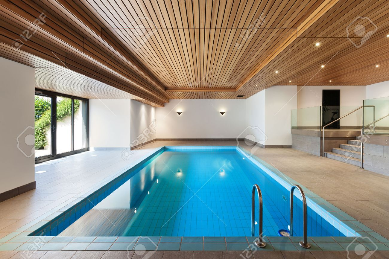 luxury homes with indoor pools luxury apartment with indoor pool wooden ceiling stock photo