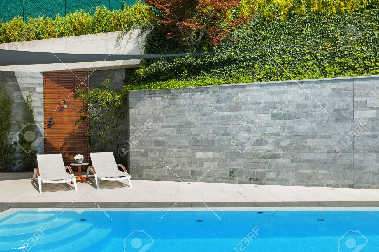 beautiful house, sunbeds view from the poolside, summer day - 47441543