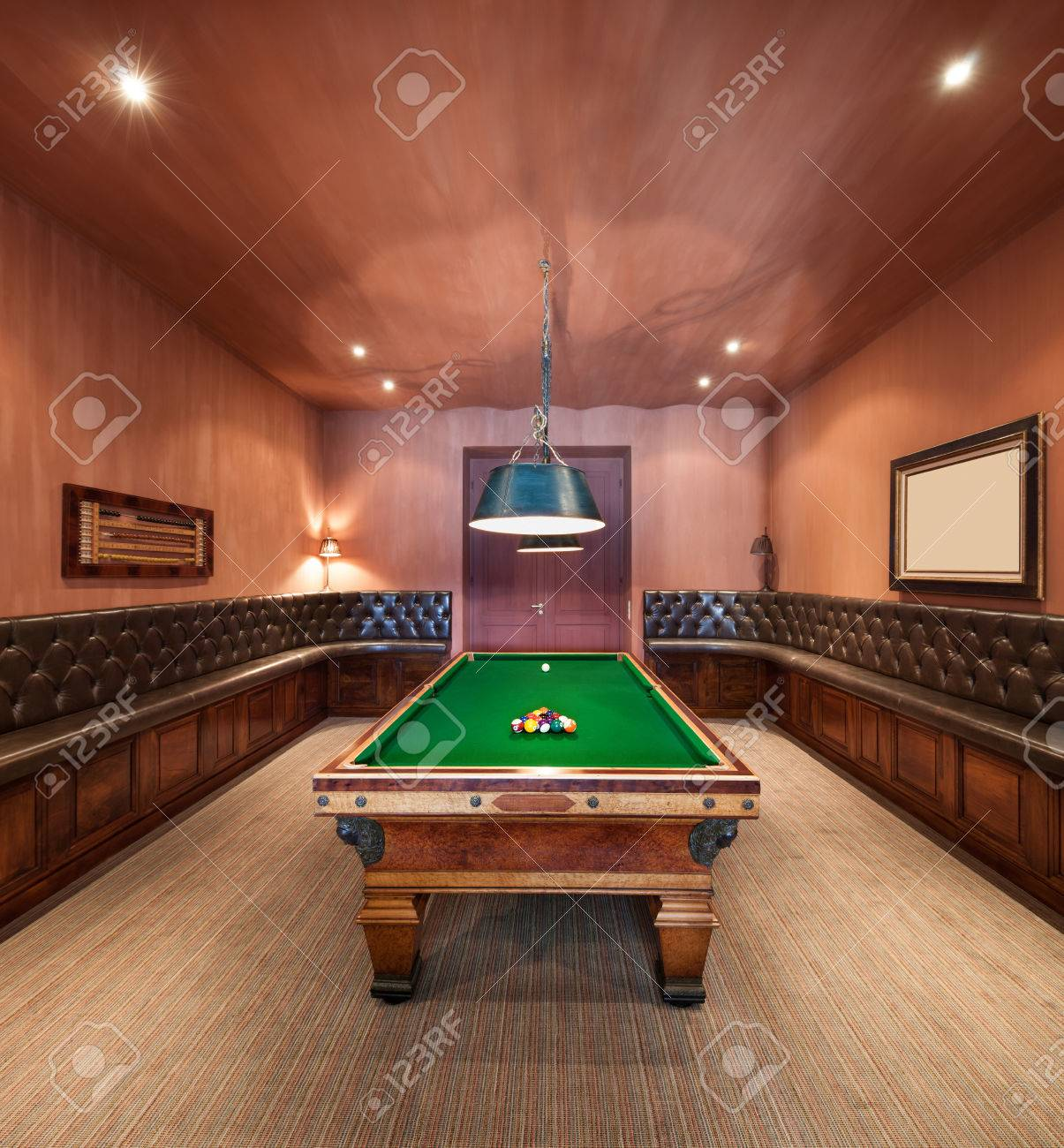 Entertainment room in luxury mansion with pool table - 48093981