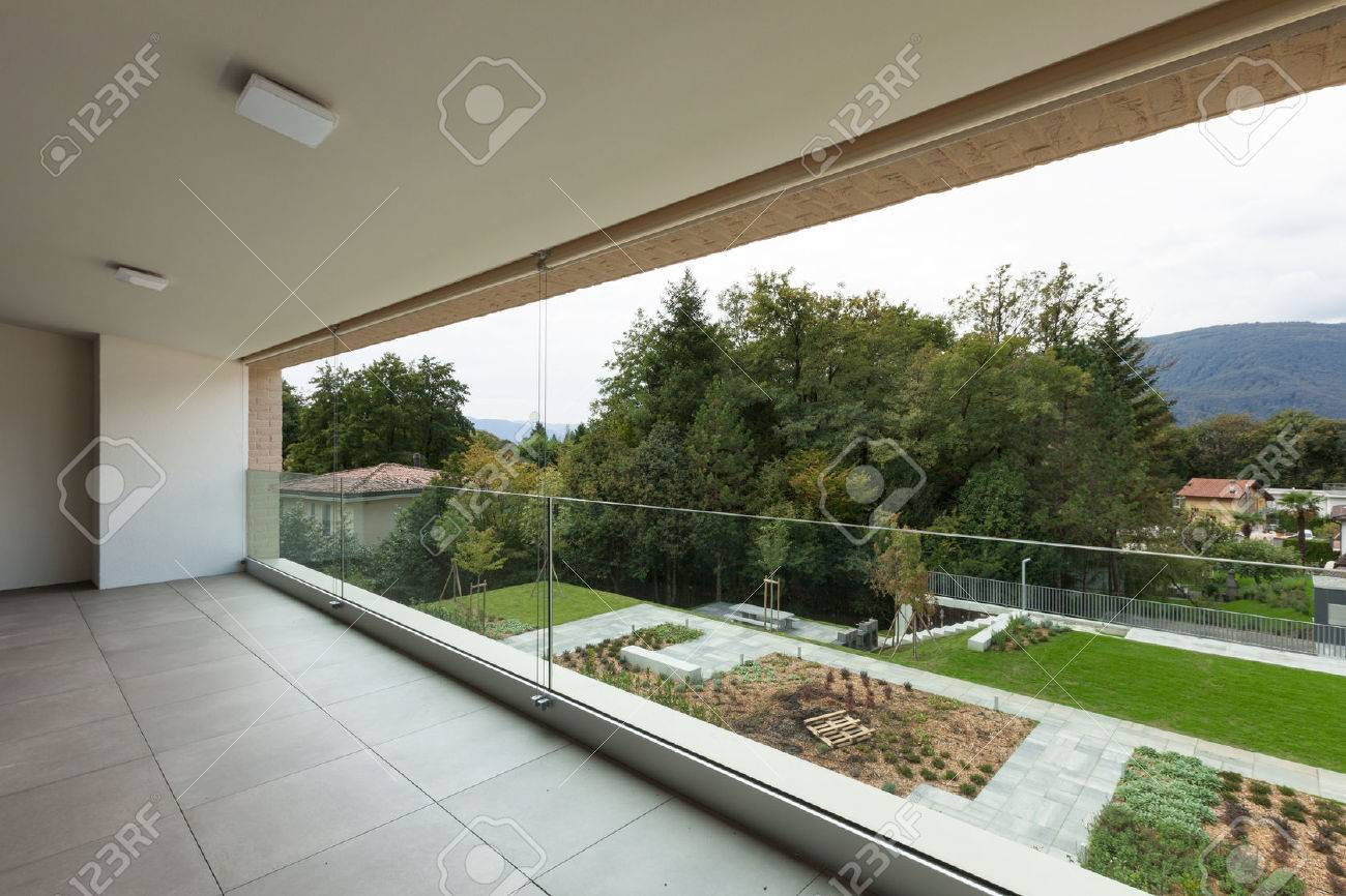 Architecture, new apartment, wide balcony with garden view - 49780815