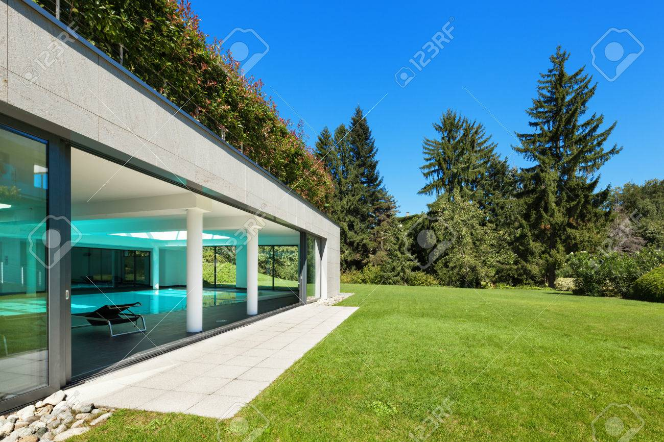 Modern house garden with indoor pool outdoors stock photo 49780918