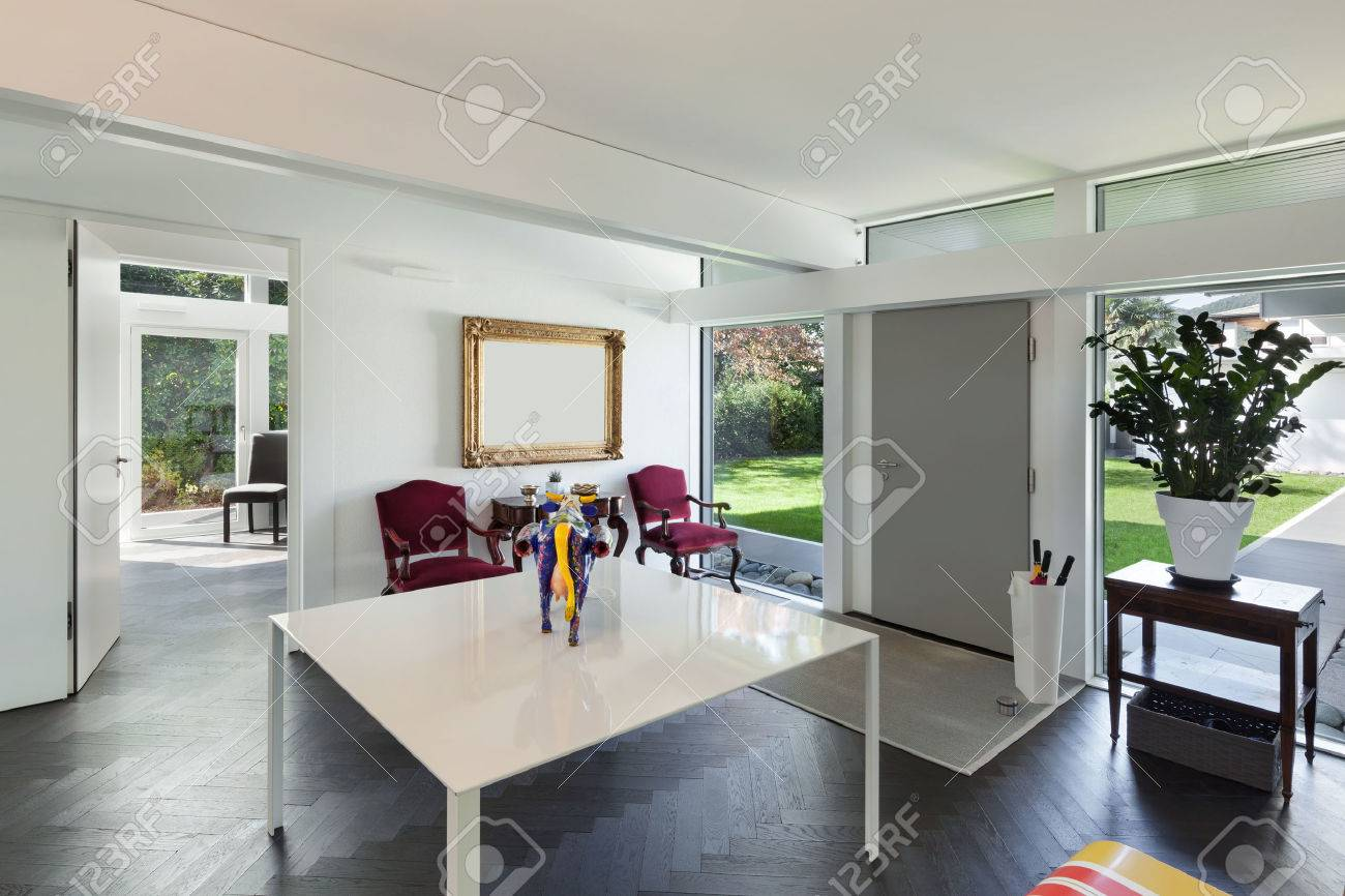 Architecture, open space of a modern house, room with table and artwork Archivio Fotografico - 49781133