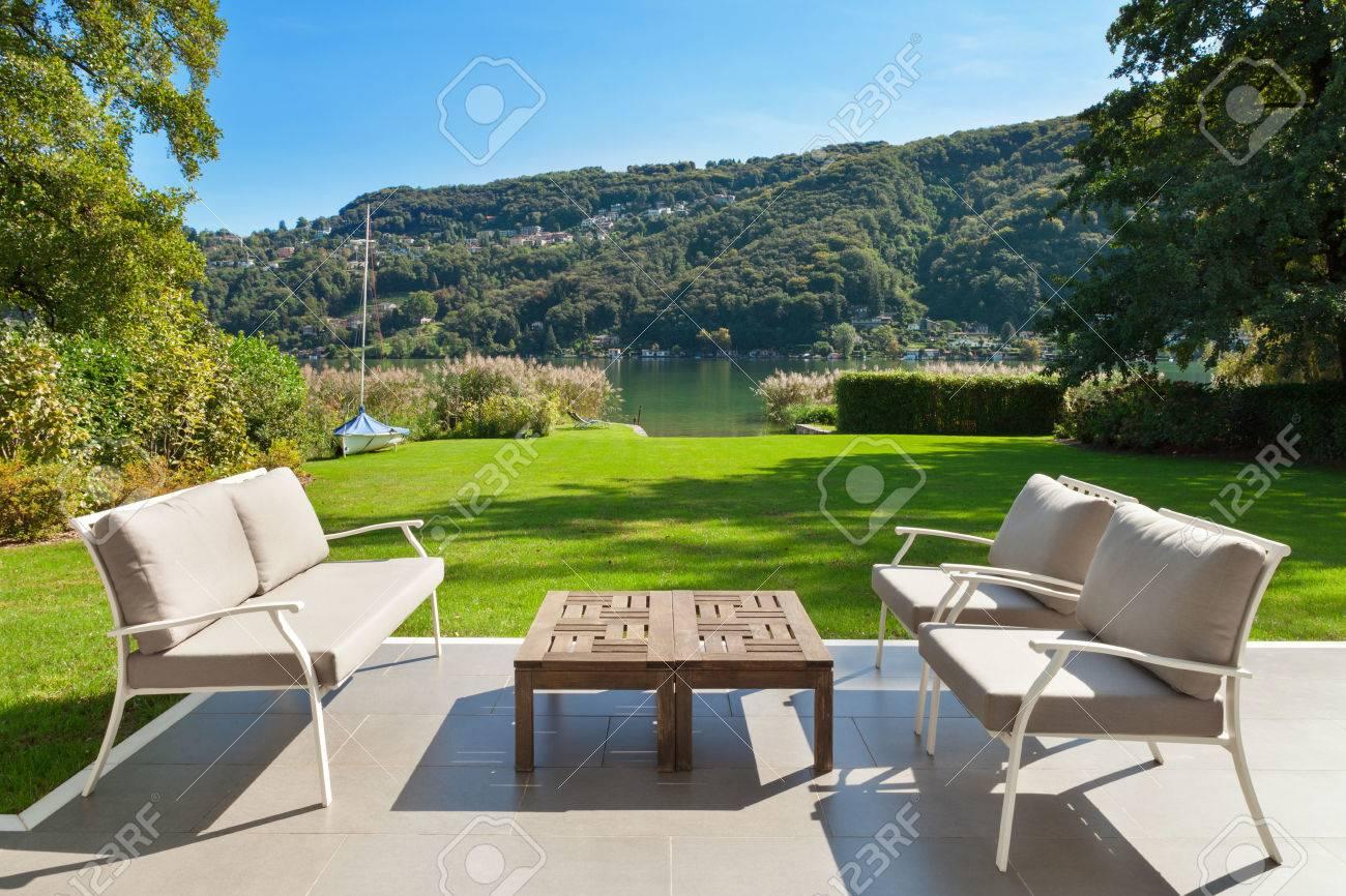 modern house outdoors, beautiful veranda in the garden - 49781199
