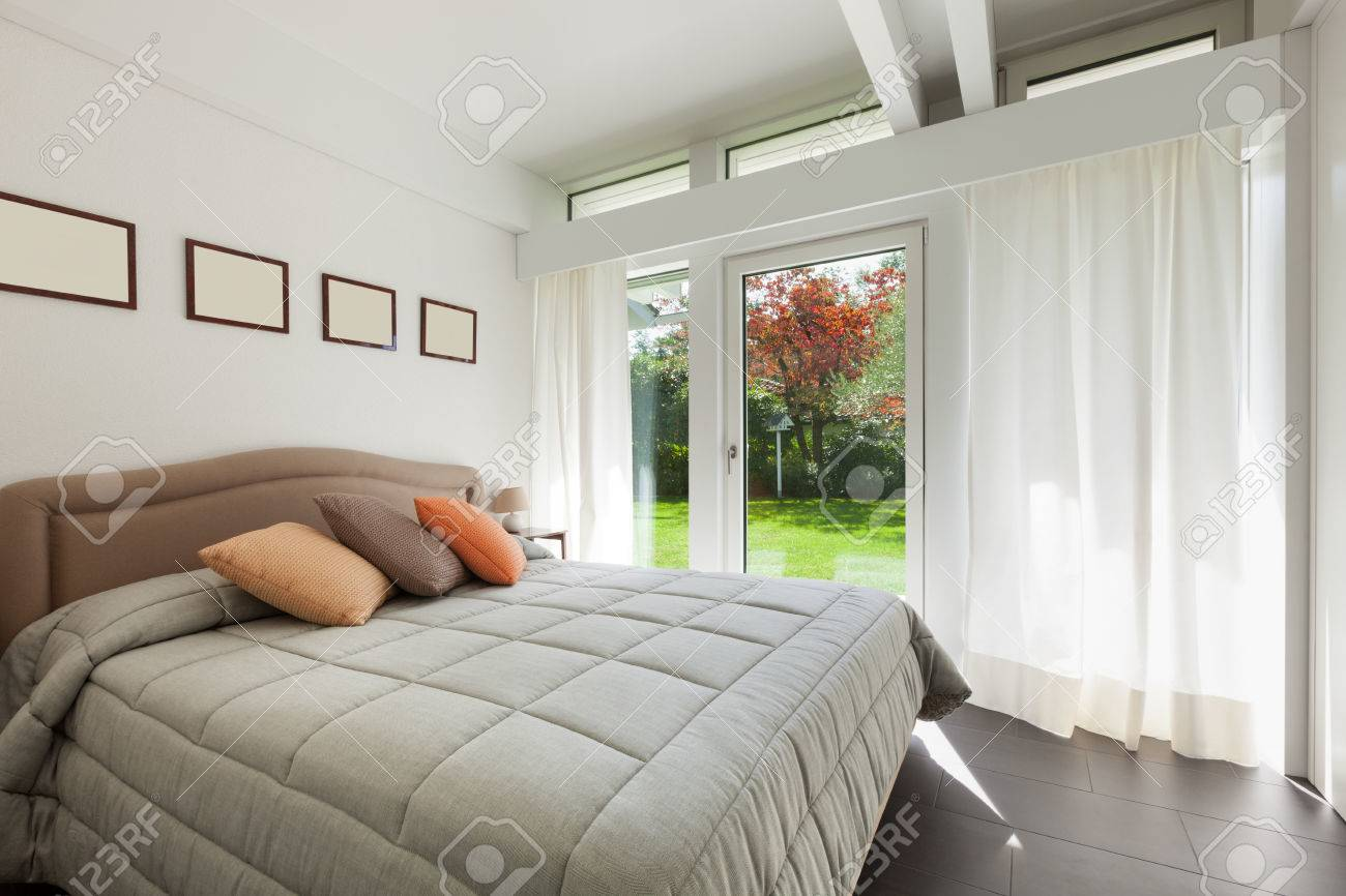 Architecture, comfortable bedroom of a modern house Standard-Bild - 49781245