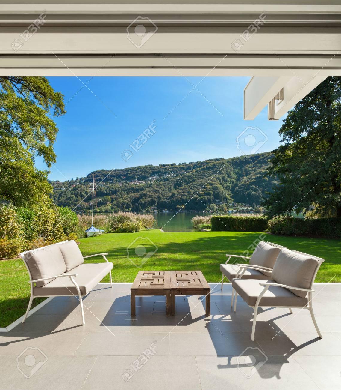 modern house outdoors, beautiful veranda in the garden - 49781324