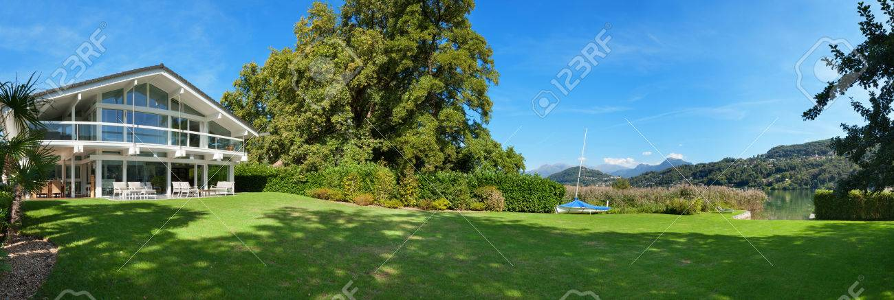 View of a beautiful house with green garden, summer day Archivio Fotografico - 49781333