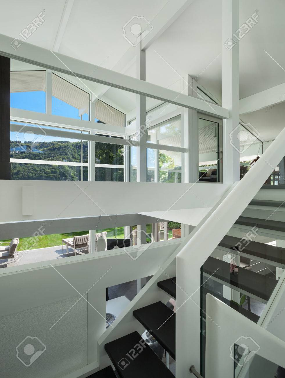 Architecture open space of a modern house staircase stock photo 49781388
