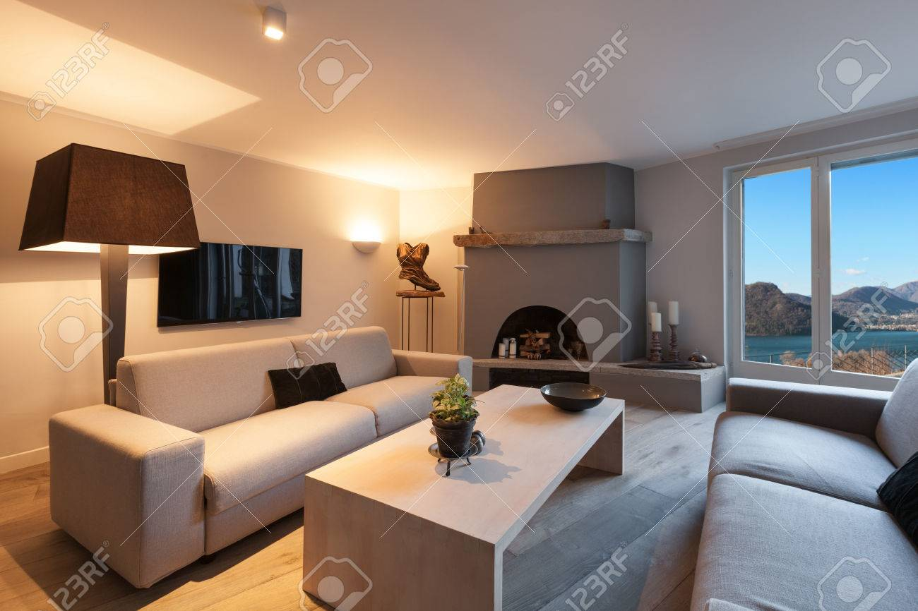 Interior of house, modern comfortable living room with fireplace - 52267024