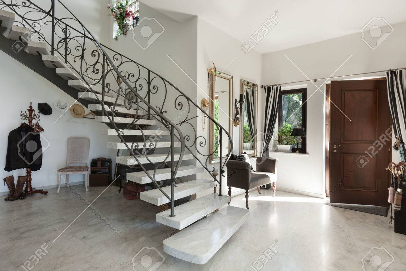 House Interior with staircase in large hall with marble floor - 53297621