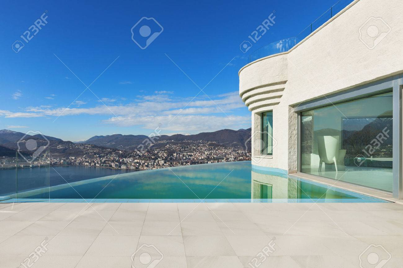 Beautiful Modern House With Infinity Pool Exterior Stock Photo