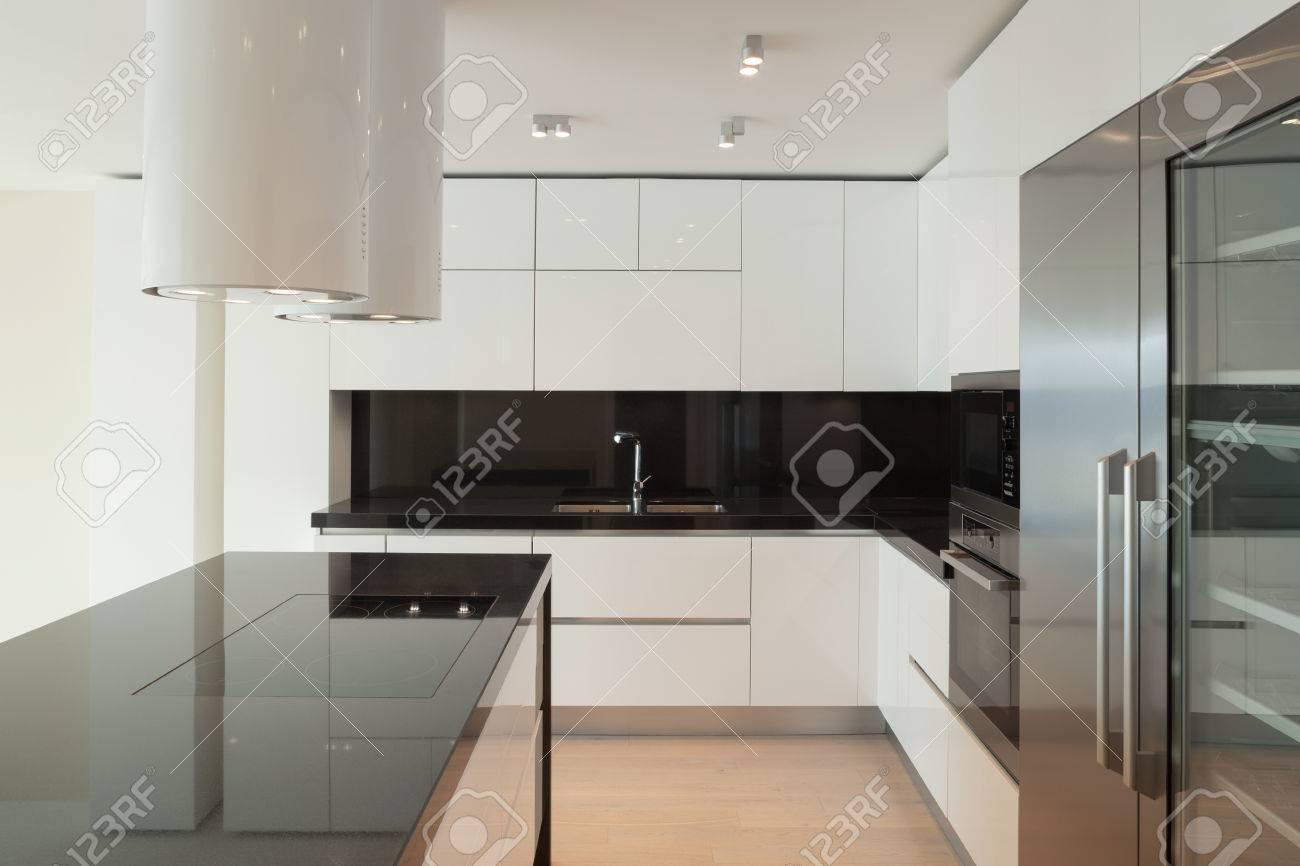 Interior of wide room with kitchen modern design - 54366063