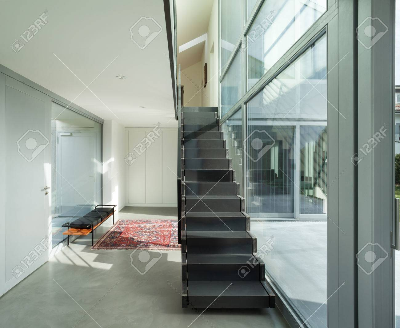 Interior of a modern house hall with iron staircase stock photo 56030500