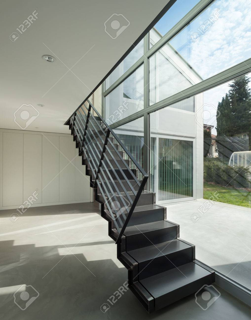 Interior iron staircase of a modern house stock photo 56030415