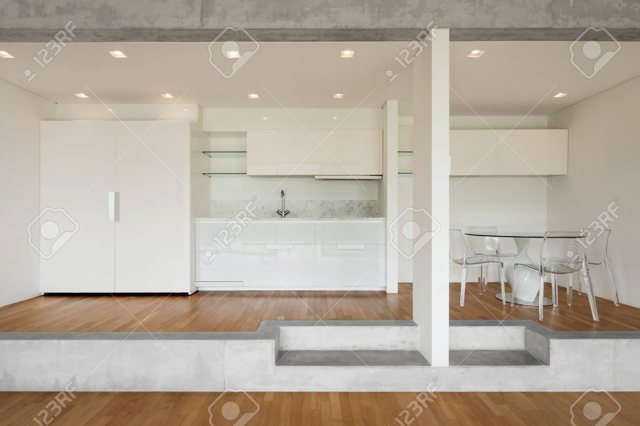 Interior Of Modern Kitchen Of Concrete Apartment With Parquet ...