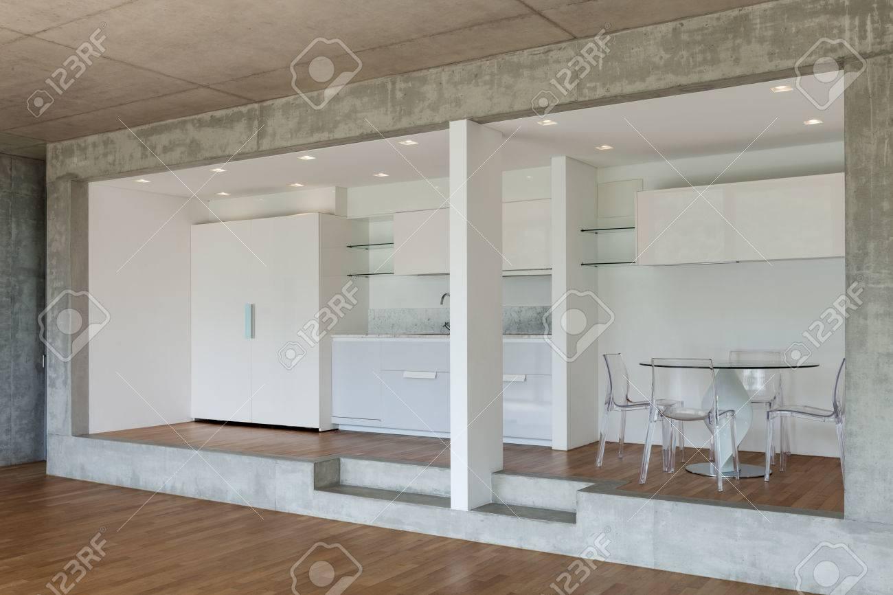foto de archivo interior de la cocina moderna de apartamento concreto con piso de parquet