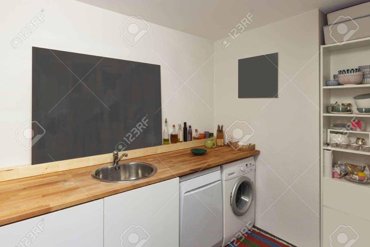 Interior of a studio apartment, washing machine and dishwasher