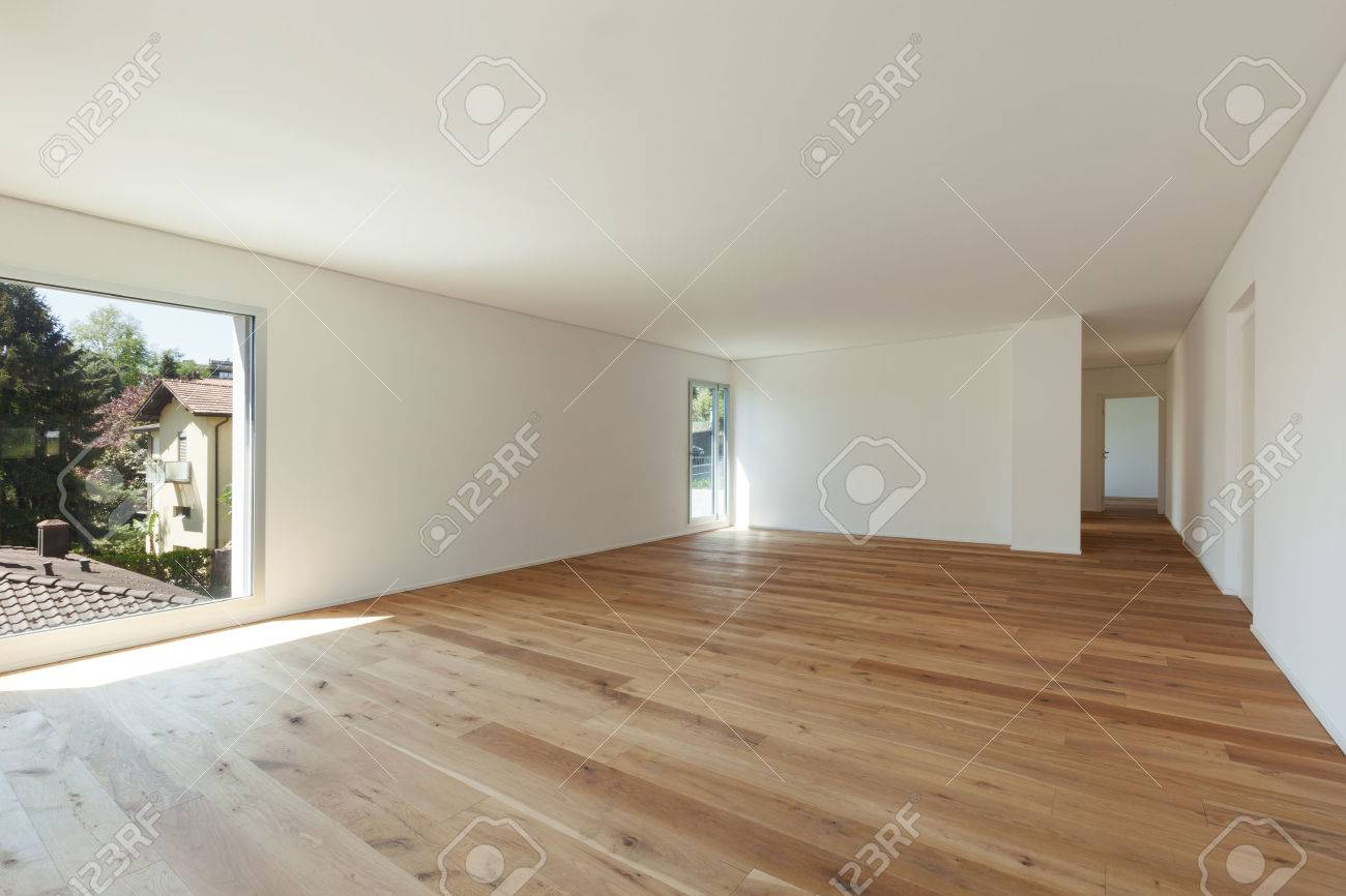interior of empty apartment wide room with parquet floor and