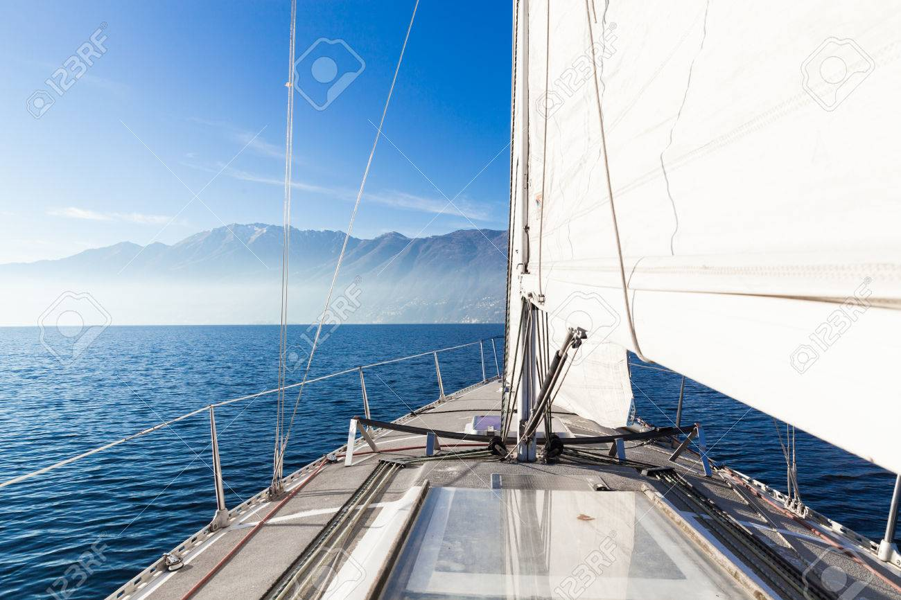 Sailing boat in sunny day in the lake - 58767558