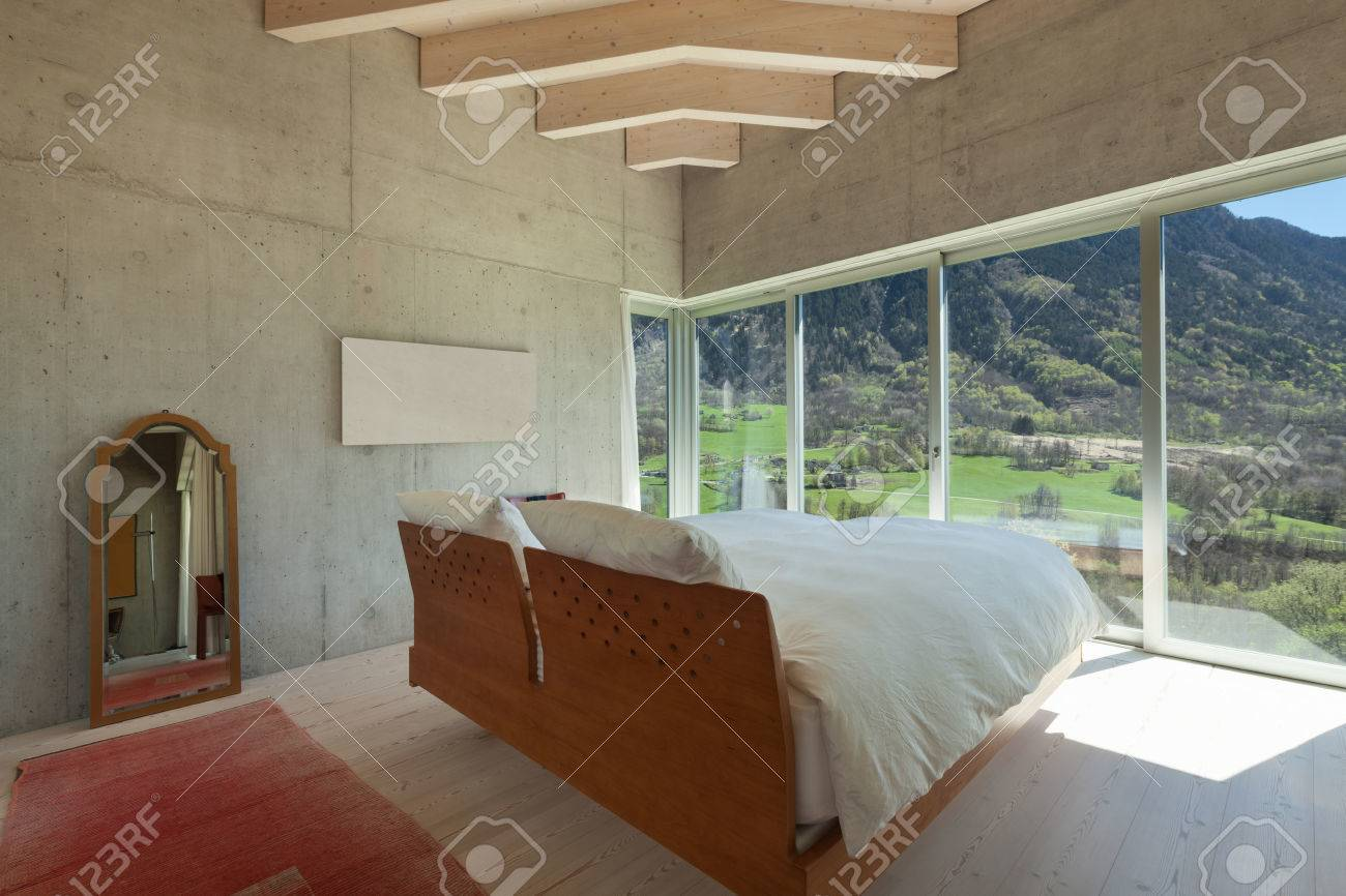 Interior Of A Modern Chalet In Cement, Bedroom Stock Photo, Picture ...