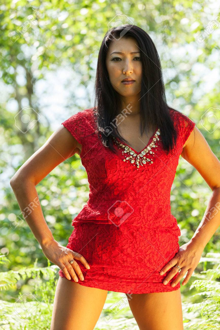 mature asian woman with red dress stock photo, picture and royalty