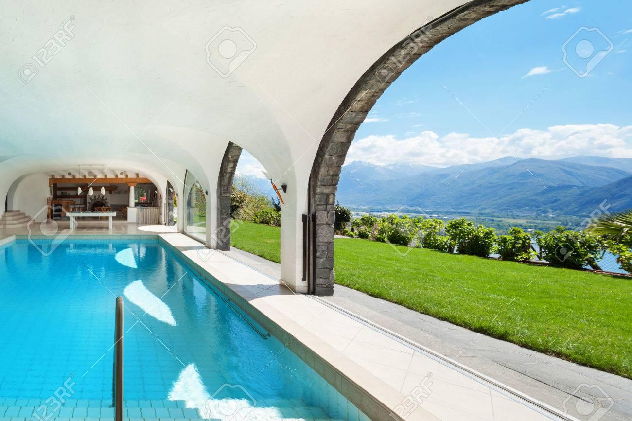 Indoor pool villa  Architecture, Luxury Villa With Indoor Swimming Pool Stock Photo ...