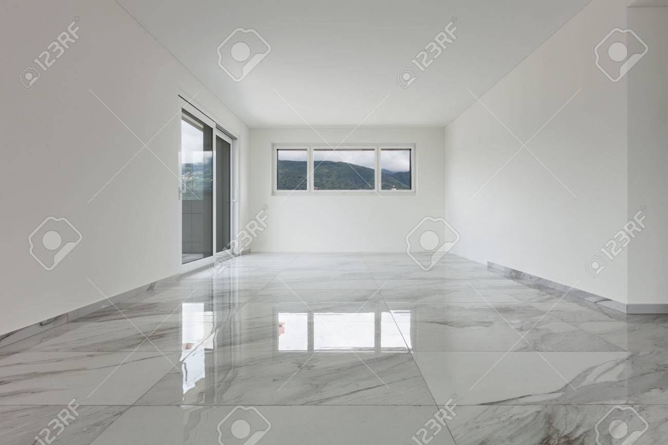 Interior of empty apartment, wide room with marble floor Archivio Fotografico - 62408861