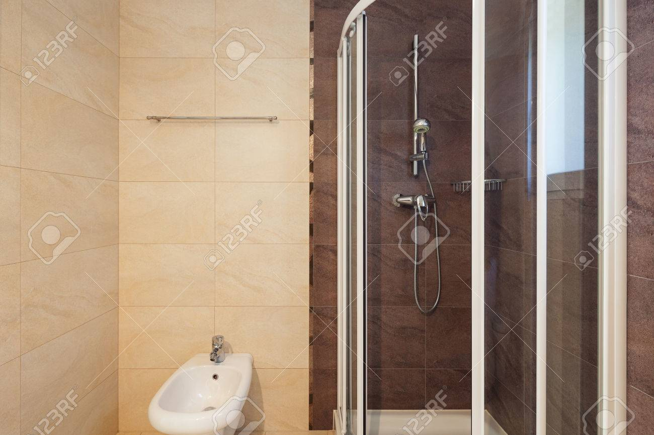 Modern Bathroom Interior With Tiled Walls, Shower Stock Photo ...