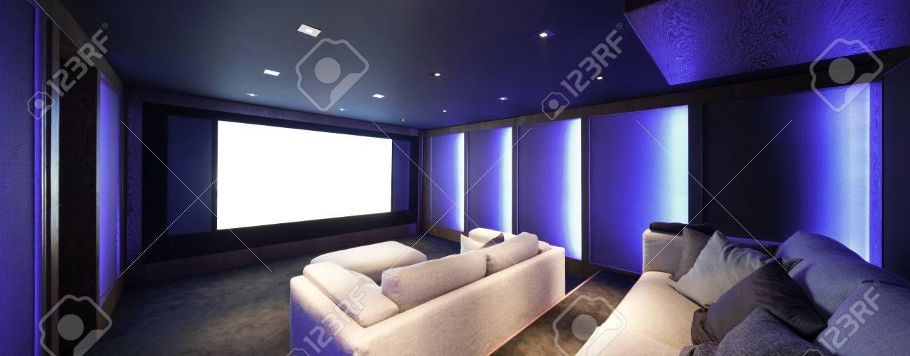 Home theater, luxury interior, comfortable divan and big screen Archivio Fotografico - 64614150