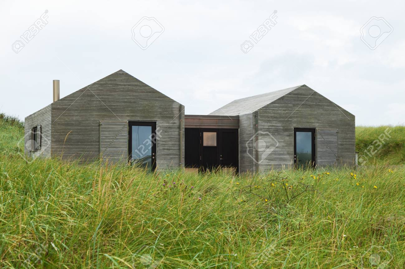 Modern Minimalist Wooden Houses Surrounded By Lawn Stock Photo