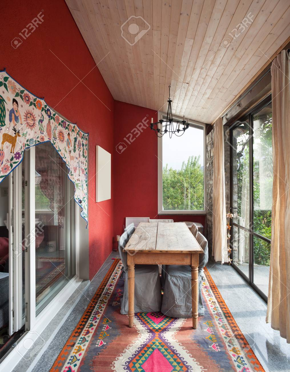 Interior Veranda With Old Dining Table Carpet On The Floor Stock Photo
