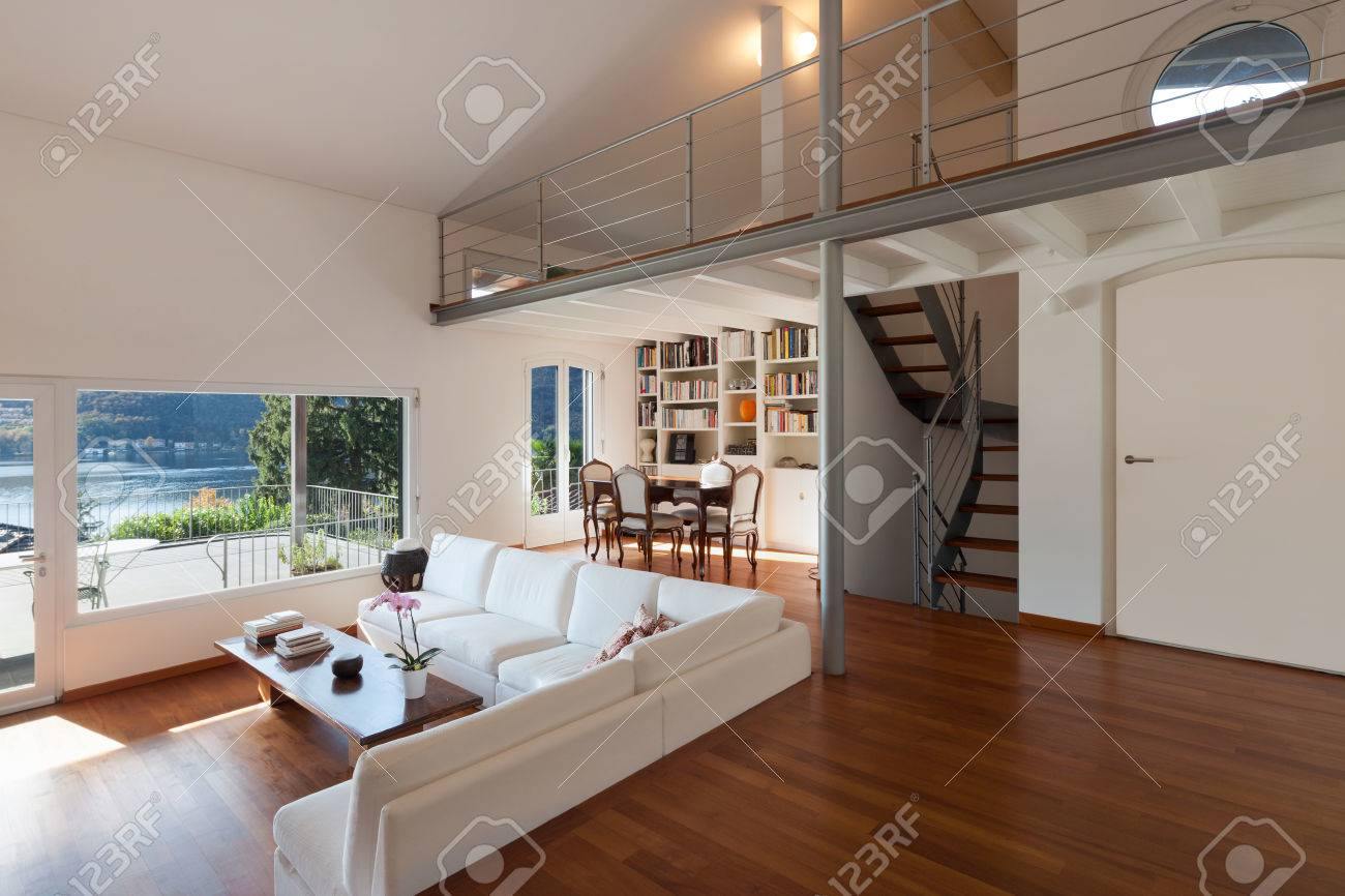 . Interiors  comfortable living room of a loft  white divans