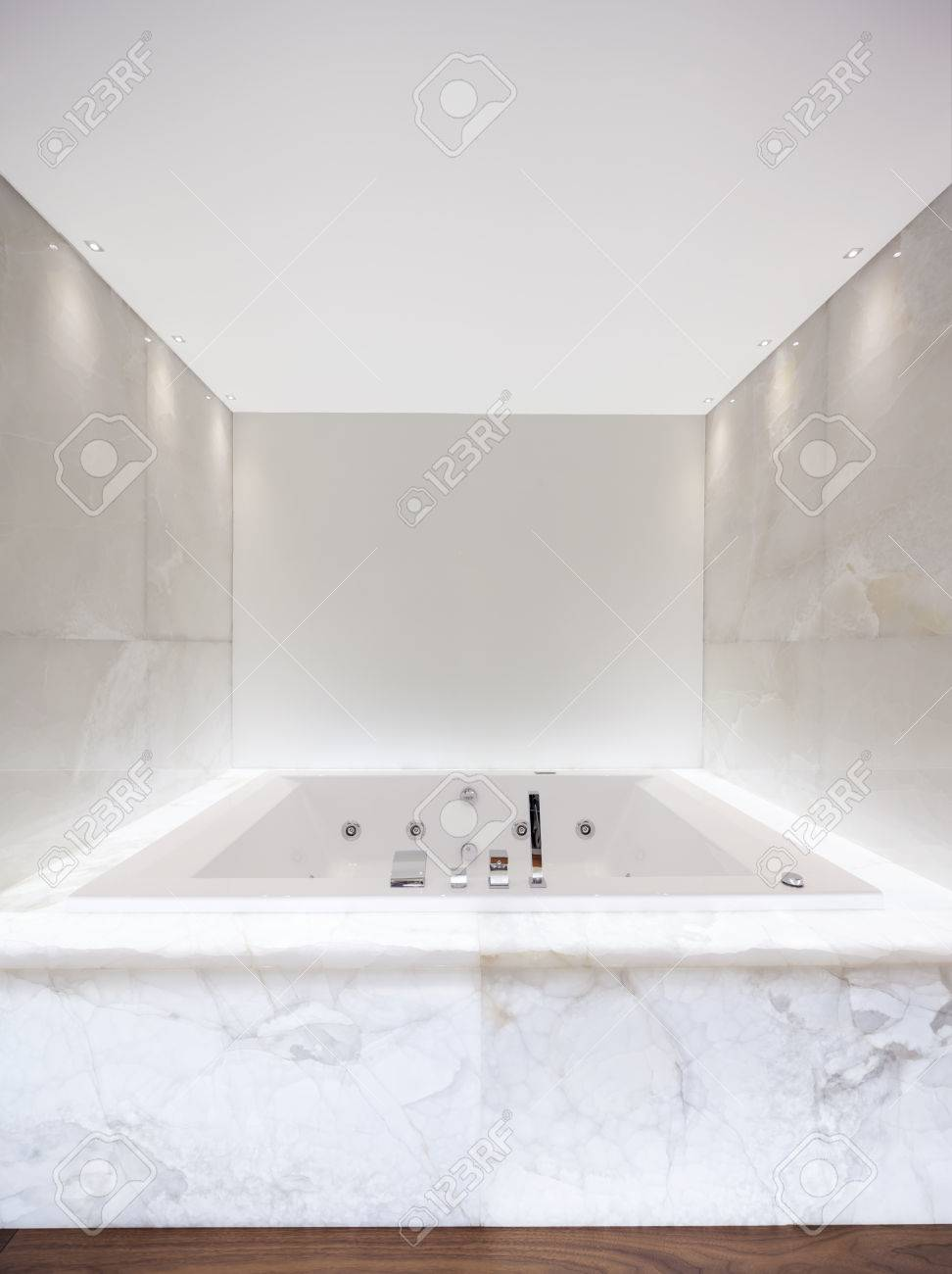 Large Bath Tub In The Bathroom Lit Marble Stock Photo, Picture And ...