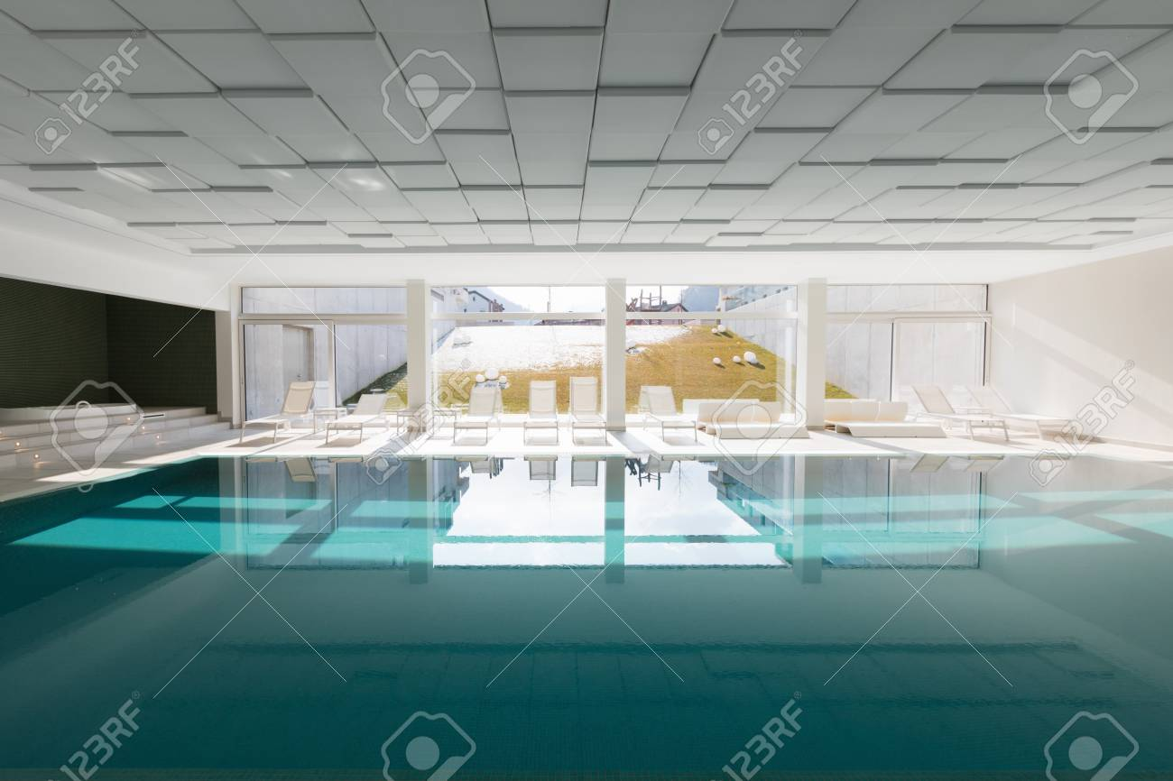 Covered swimming pool in a private residence overlooking the..