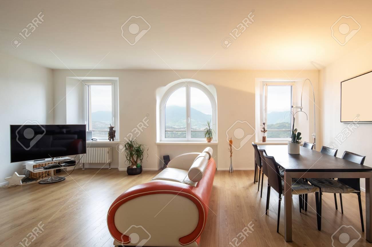 living room with leather and parquet design sofa large windows rh 123rf com parquet living room decorating parquet floor living room