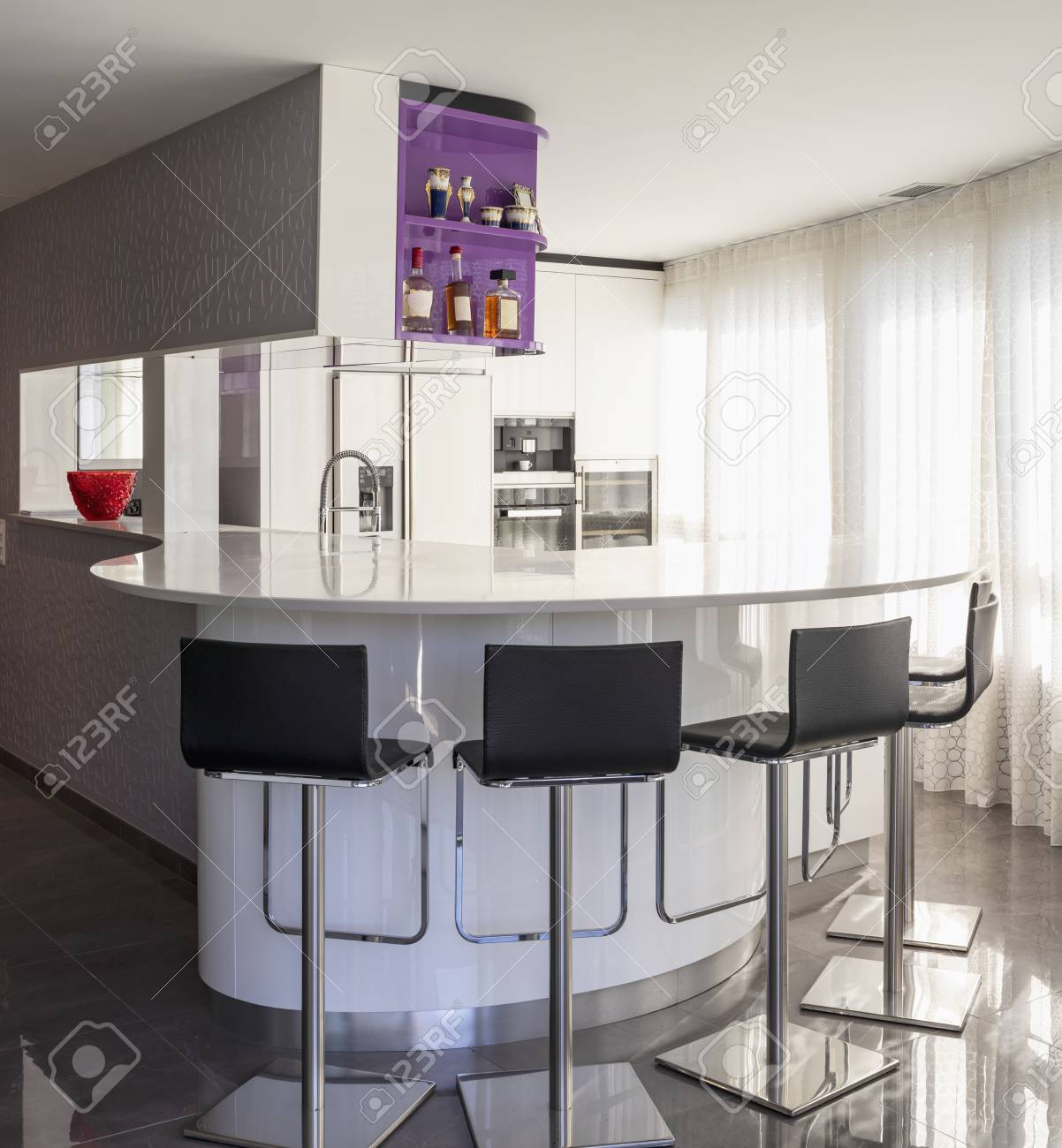 Kitchen With Purple And White Wardrobe Black Counter Elegant Stock Photo Picture And Royalty Free Image Image 114303382