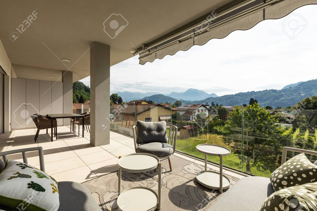 Balcony with outdoor furniture in luxury house. Nature view... on cedar furniture, home nature hamptons, wood furniture, apartment furniture, living room furniture, odd furniture, rustic bedroom furniture, redwood furniture, burl furniture,