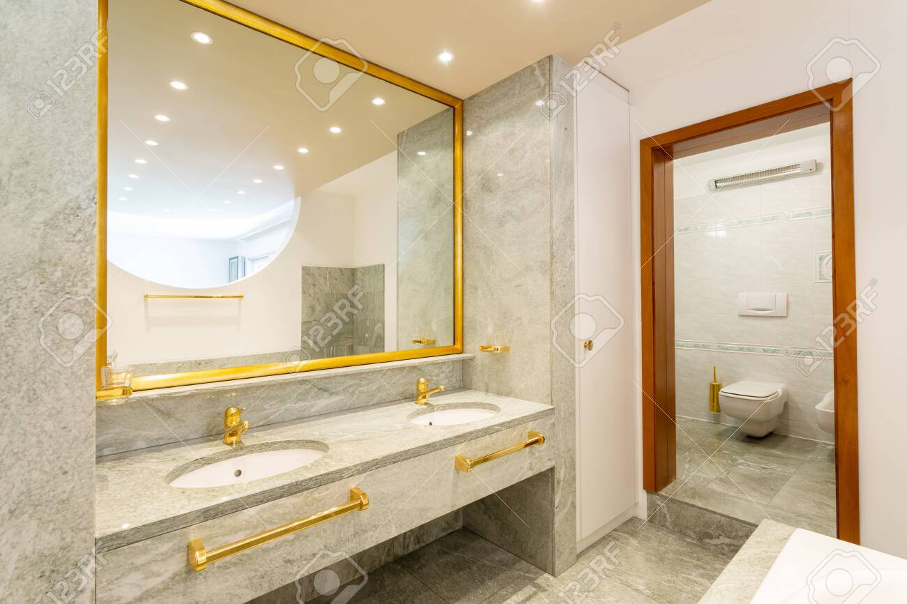 Luxury Bathroom With Green Marble And Gold Sinks Nobody Inside Stock Photo Picture And Royalty Free Image Image 129223503