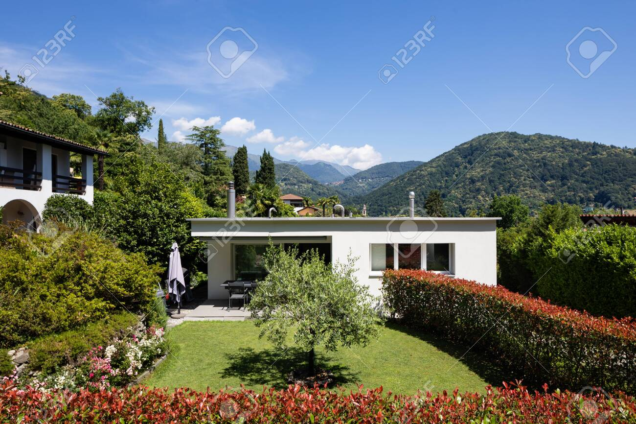 Small House For A Family With A Beautiful Garden Small But Nice Stock Photo Picture And Royalty Free Image Image 130118610