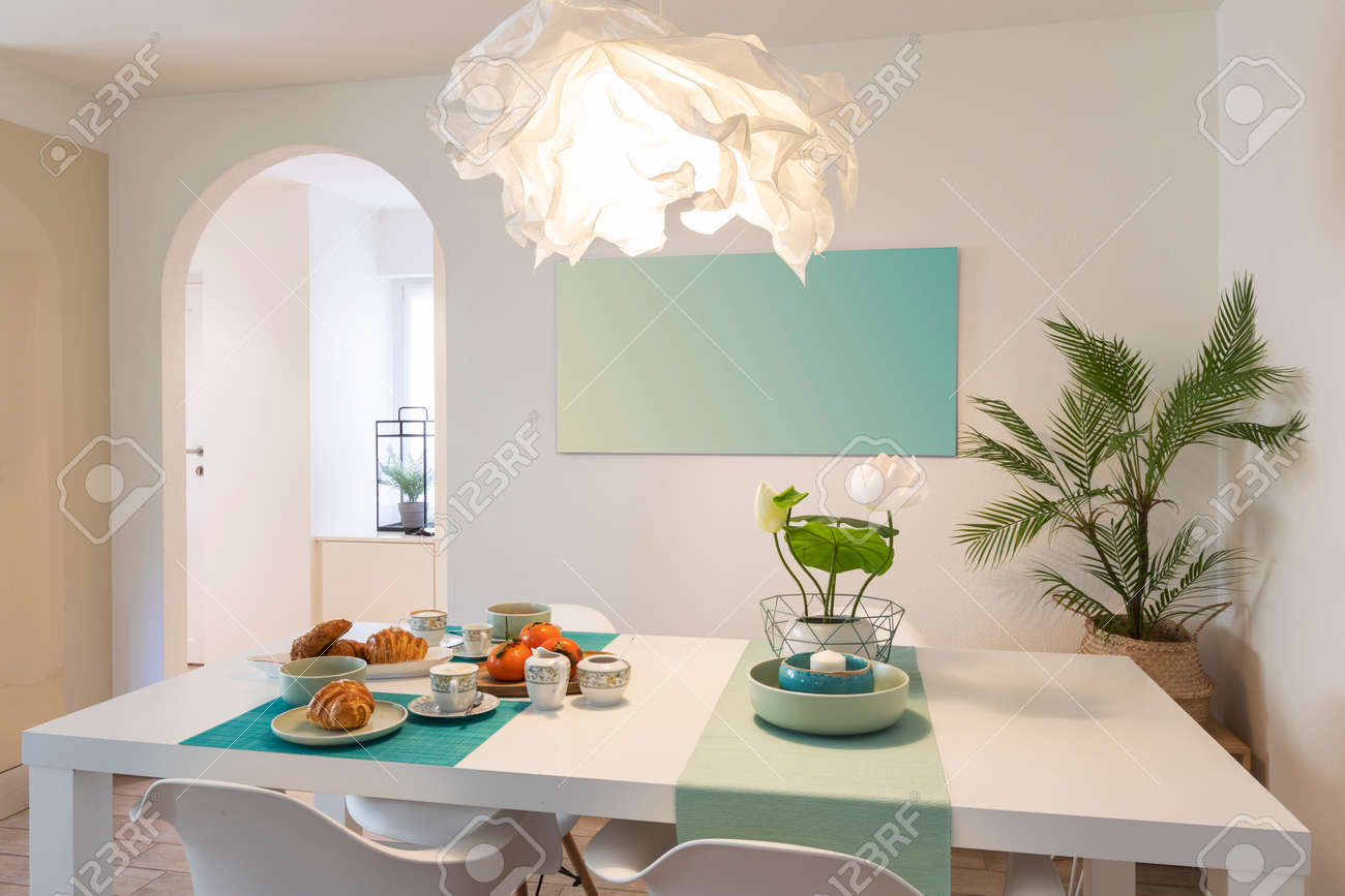 Elegant and romantic white table ready for breakfast with brioche, cups for coffee and fruits. Nobody inside - 163078101