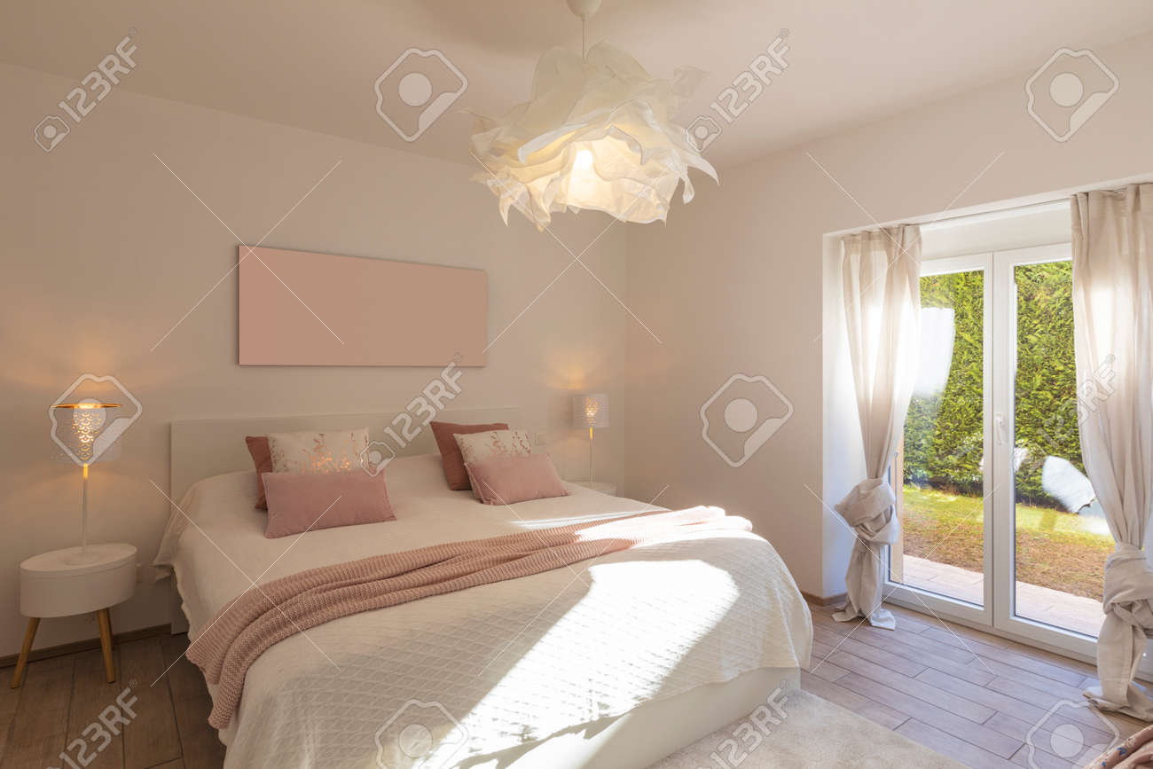 Modern, bright and luxury bedroom in design apartament. Fresh bed sheets and pillows above. Minimal and elegant. - 163078158