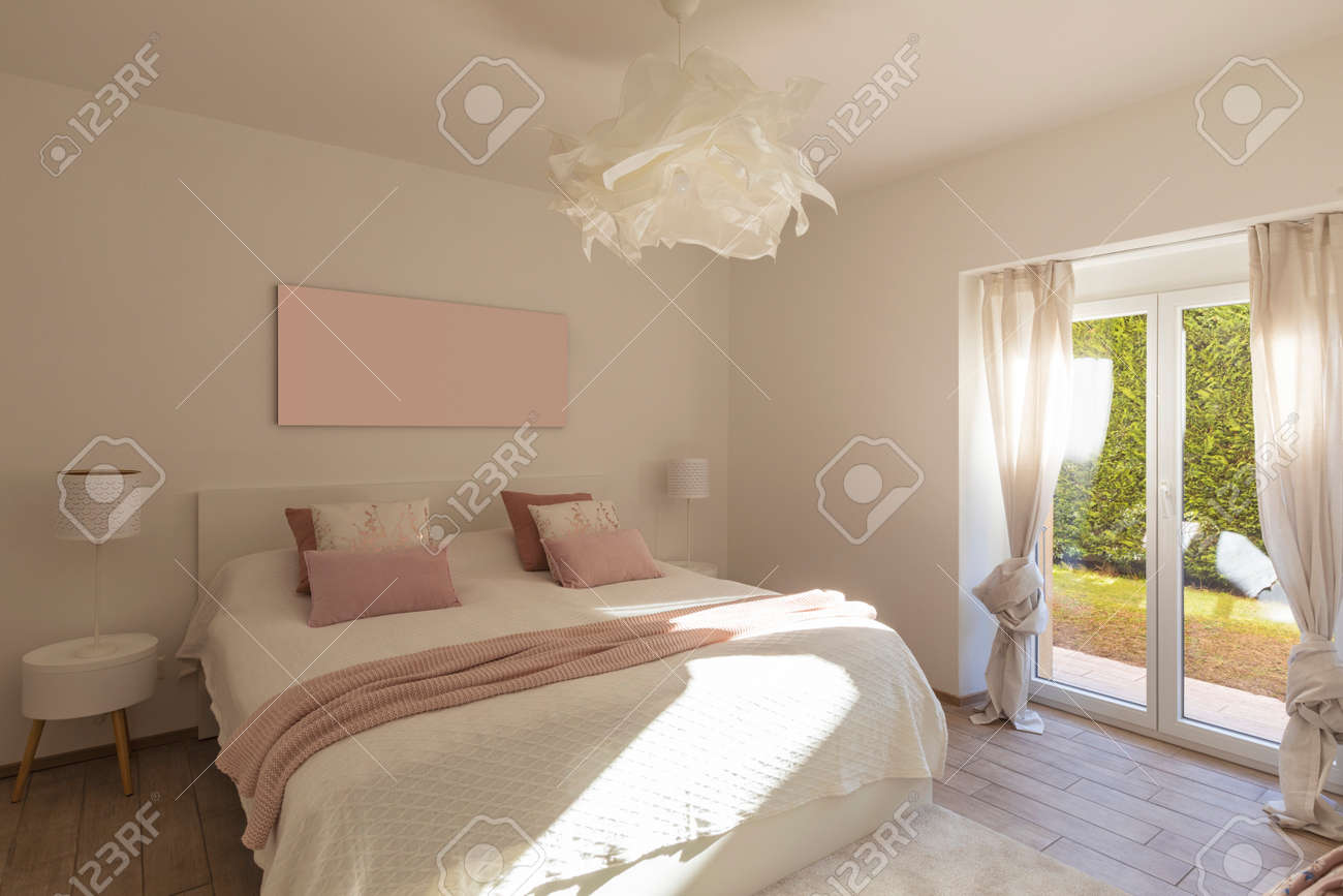 Modern, bright and luxury bedroom in design apartament. Fresh bed sheets and pillows above. Minimal and elegant. - 163079130