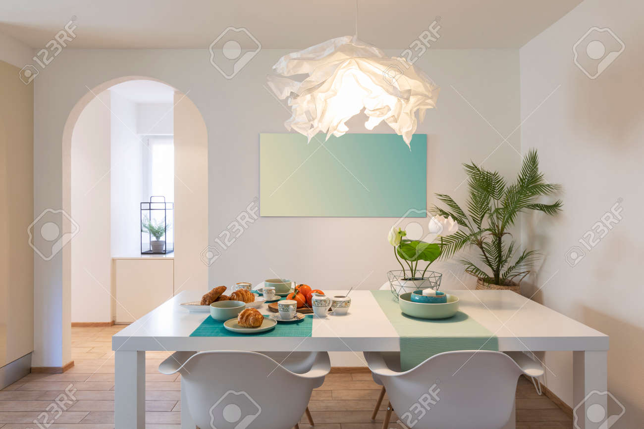 Elegant and romantic white table ready for breakfast with brioche, cups for coffee and fruits. Nobody inside - 163079133