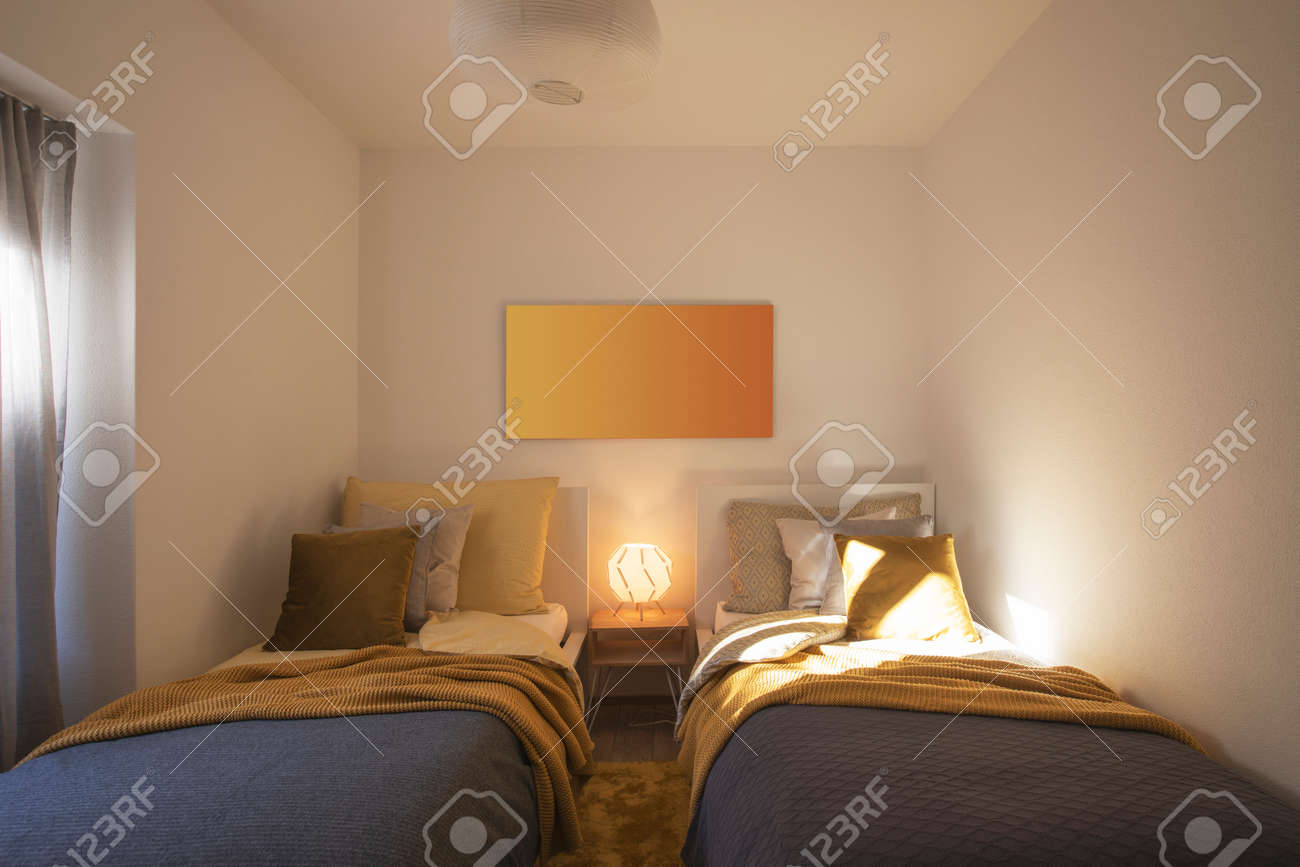 Modern bedroom with two singles beds with clean bed sheets and large pillow above. White wall. Nobody inside. - 163079135