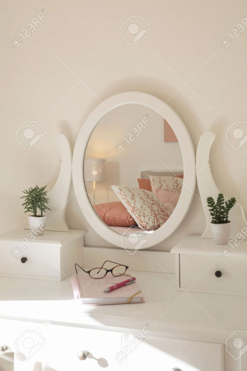 Detail of makeup dressing table with large mirror, diary and organizer. White and clean workstation in the master bedroom. Nobody inside. - 163079141