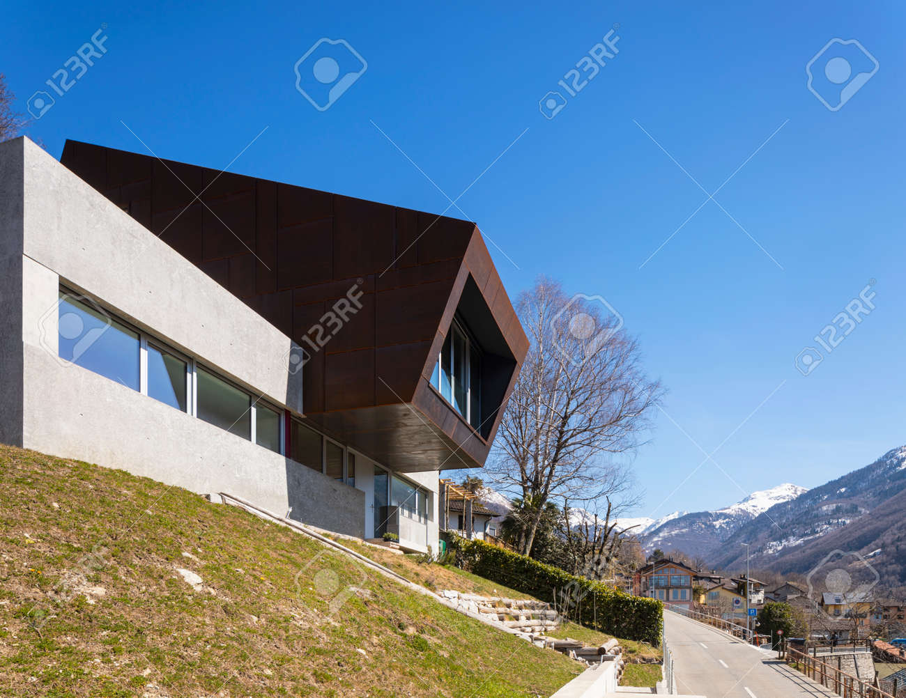 Exterior modern isolated villa, surrounded by nature. Iron and concrete cladding. Nobody inside - 166389494