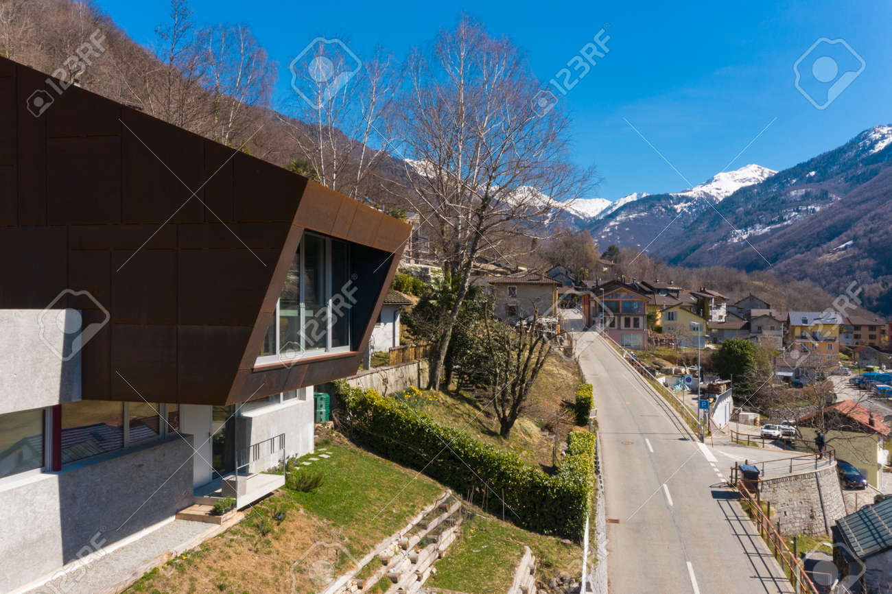 Exterior modern isolated villa, surrounded by nature. Iron and concrete cladding. Nobody inside - 166495249