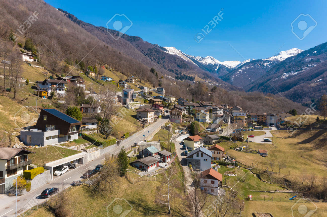 Aerial view of the Morobbia Valley, winter landscape on a sunny day with snow on the mountains. Blue sky - 166495253