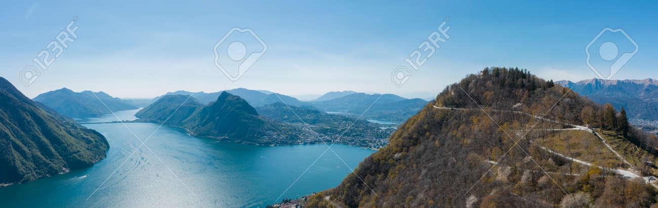 Aerial view of Lugano lake, Lugano city and Monte Brè in Canton Ticino in southern Switzerland. Sunny day - 170380127